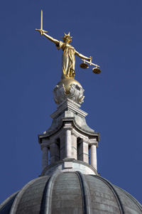 statue of Justice, atop the High Court in London